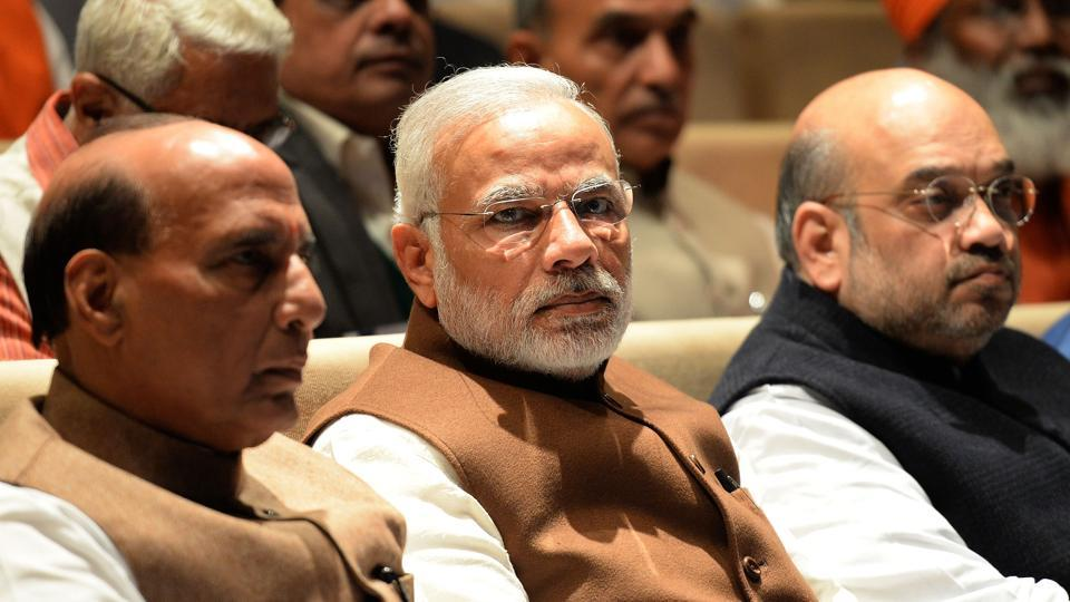 Prime Minister Narendra Modi (C, home minister Rajnath Singh (L) and BJP president Amit Shah (R) look on during the BJP's parliamentary committee meeting at Parliament House in New Delhi on December 16, 2016. The two-day meet, presided by BJP president Amit Shah, will be addressed by Prime Minister Narendra Modi on Saturday.