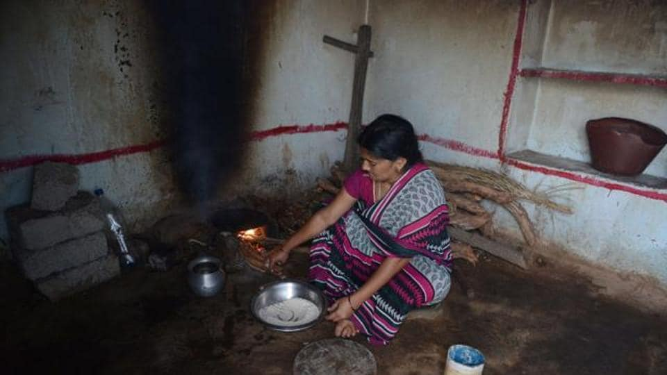 In this photograph taken on October 5, 2015, a tribal widow K Vijaya, who lost her husband in a road accident, prepares food at her home in the village of Peddakunta, some 56 km from Hyderabad. The Telangana government is announced a grant Rs 1,000 monthly wages to distressed lonely women in the state who may be pushed into poverty.