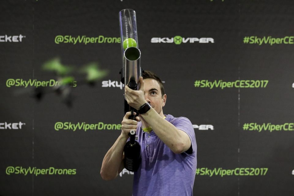 James Woodbury participates in a drone hunting challenge at the Sky Viper booth at CES International in Las Vegas.  (AP)