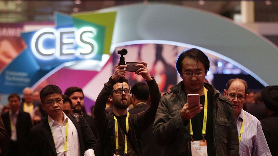 Attendees visit CES 2017 at the Las Vegas Convention Center in Las Vegas, Nevada. CES, the world's largest annual consumer technology trade show, runs through January 8 and features 3,800 exhibitors showing off their latest products and services to more than 165,000 attendees.  (AFP)