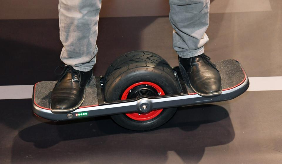 Brandon Yamawaki demonstrates the Jyro Roll at CES 2017 at the Sands Expo and Convention Center in Las Vegas, Nevada. The $1,299, self-balancing, single-wheel skateboard will be available in the Fall of 2017.  (AFP)