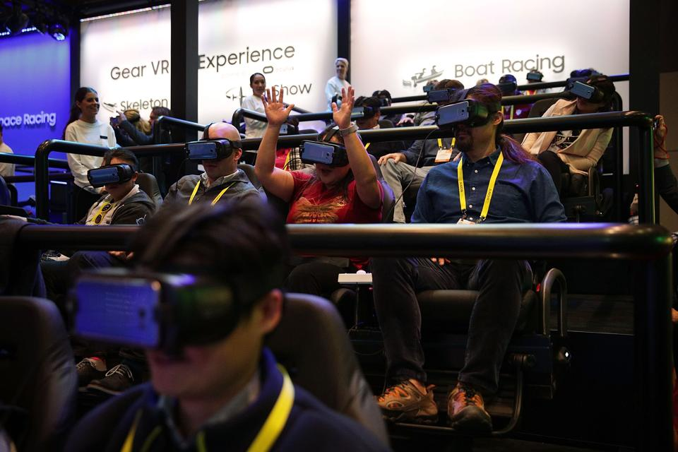 Attendees participate in the Samsung VR 4D Boat Racing Experience during CES 2017 at the Las Vegas Convention Center in Las Vegas, Nevada.  (AFP)