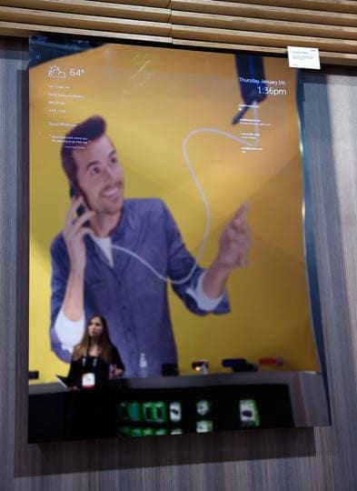A Connected Mirror is displayed at the Griffin booth at CES 2017 at the Las Vegas Convention Center in Las Vegas, Nevada. The mirror can be programmed to display information such as the weather as well as incoming messages.  (AFP)
