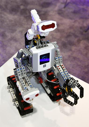 An Abilix Krypton 7 humanoid robot is displayed at CES 2017 at the Sands Expo and Convention Center in Las Vegas, Nevada. The educational robot features 1,001 components and has four levels of software to help teach students as they program and build it.  (AFP)