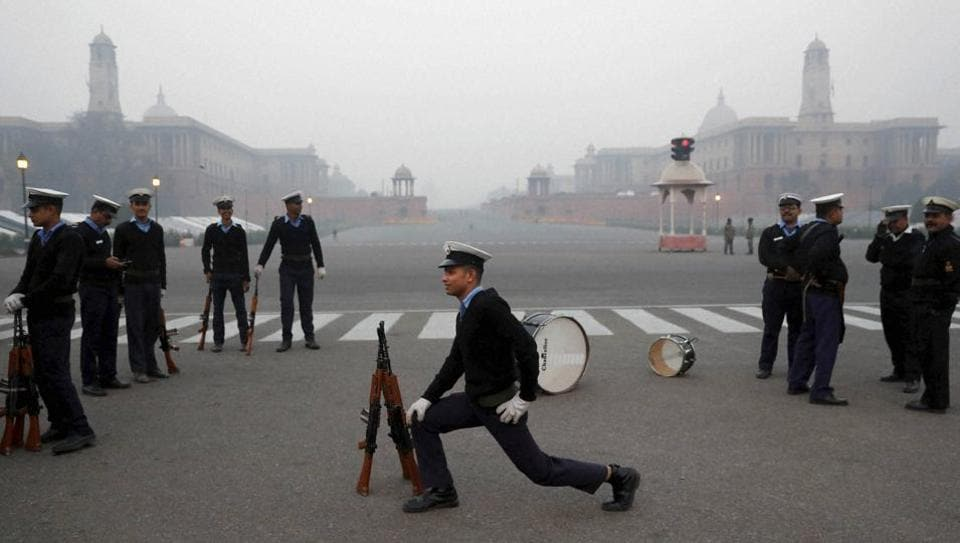 An Indian Coast Guard soldier stretches during a rehearsal ahead of the Republic Day parade in New Delhi on Thursday. Delhi mornings are likely to get slightly foggier over the coming weekend, with chances of light rain and cloudy skies.