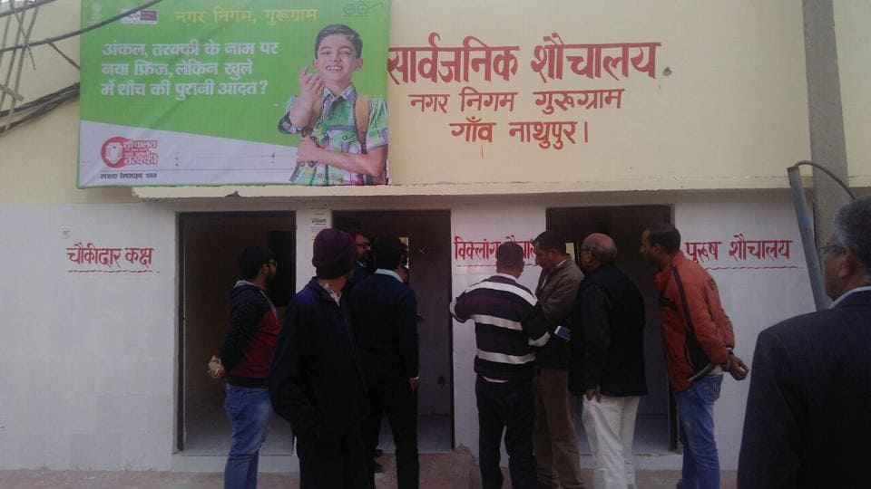 MoUD officials inspect toilets as part of the Swachh survey in Gurgaon.