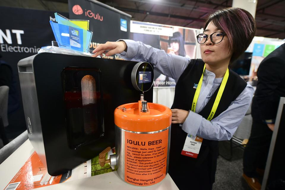 Huiyan Gao gives a demonstration of the iGulu during the 2017 Consumer Electronic Show (CES) in Las Vegas, Nevada. The iGulu is an automated home craft brewery from the Shanghai Haoyang Network Technology Company. (AFP)
