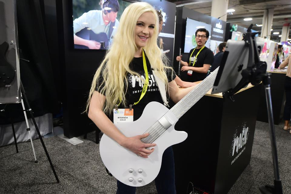 Miranda Gold poses while playing the MI Guitar from Magic Instruments during the 2017 Consumer Electronic Show (CES) in Las Vegas, Nevada . The guitar was designed by a Julliard-trained musician mixing technology with tradition. (AFP)
