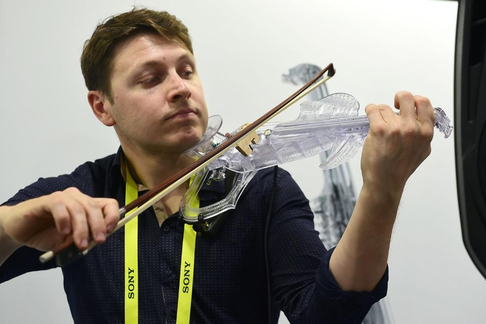 Laurent Bernadac gives a demonstration on the 3Dvarius electric violin during the 2017 Consumer Electronic Show (CES) in Las Vegas, Nevada. The violin was created using 3D printing technology and based on the model of a real Stradivarius violin. (AFP)