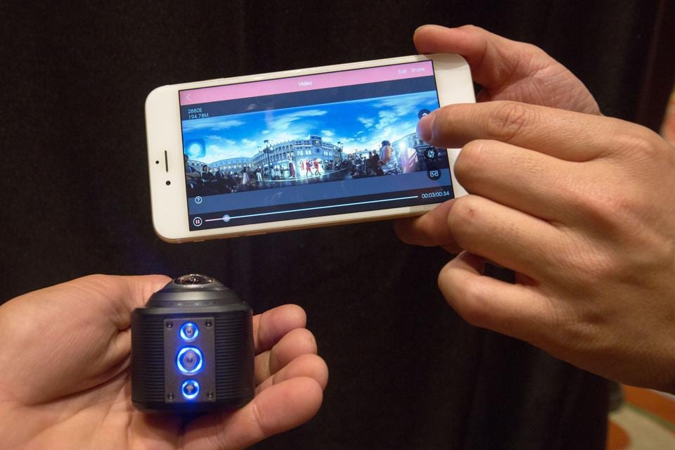 A Camerama 4K panoramic camera (L) and smart phone app are shown at ShowStoppers during the 2017 Consumer Electronic Show (CES) in Las Vegas, Nevada. (AFP)