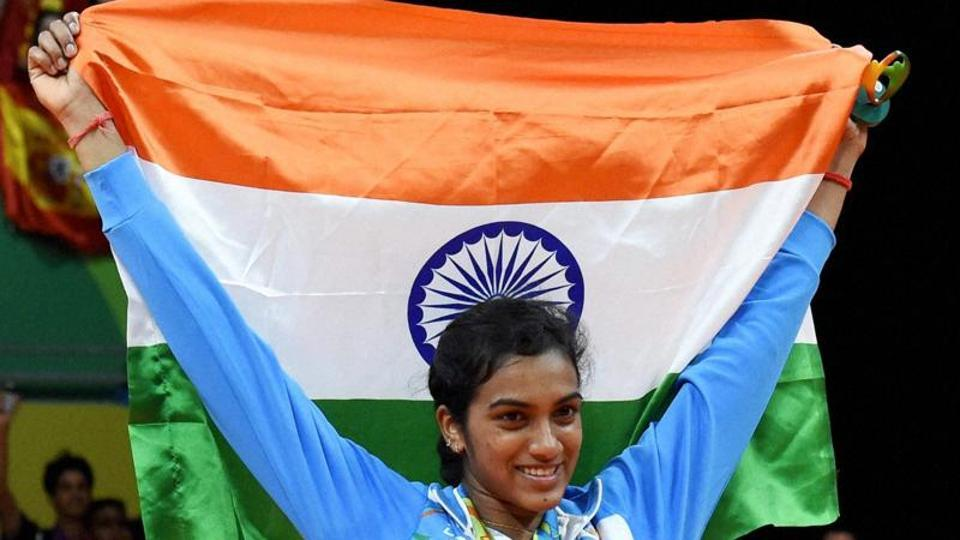 PV Sindhu poses with National flag after winning the silver medal in the badminton women's singles Final at the 2016 Summer Olympics at Rio de Janeiro in Brazil.
