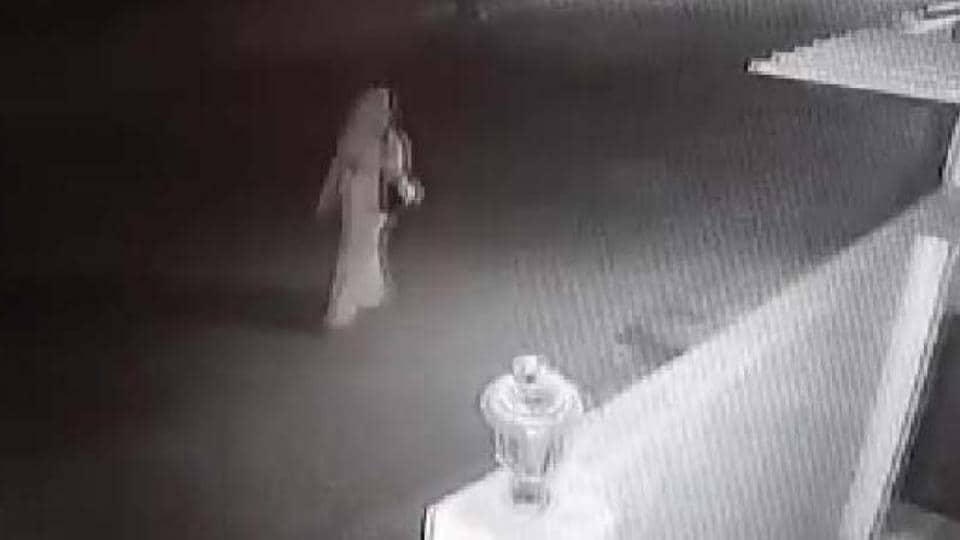 The woman walks towards a bus stop near her residence in Bengaluru's KGHalli, where she was allegedly assaulted.