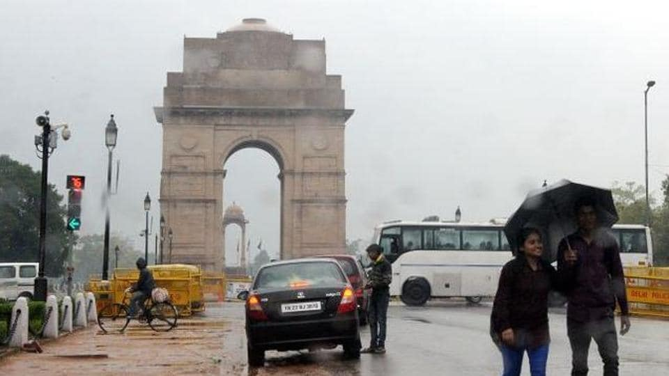 It was a rain-soaked morning in the national capital on Saturday with the minimum temperature recorded at 13.5 degrees Celsius, six notches above the season's average