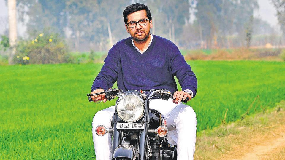 RIDING HIGH ON LEGACY: Youngest Congress candidate Angad Singh Saini on his Royal Enfield motorcycle.Photo by