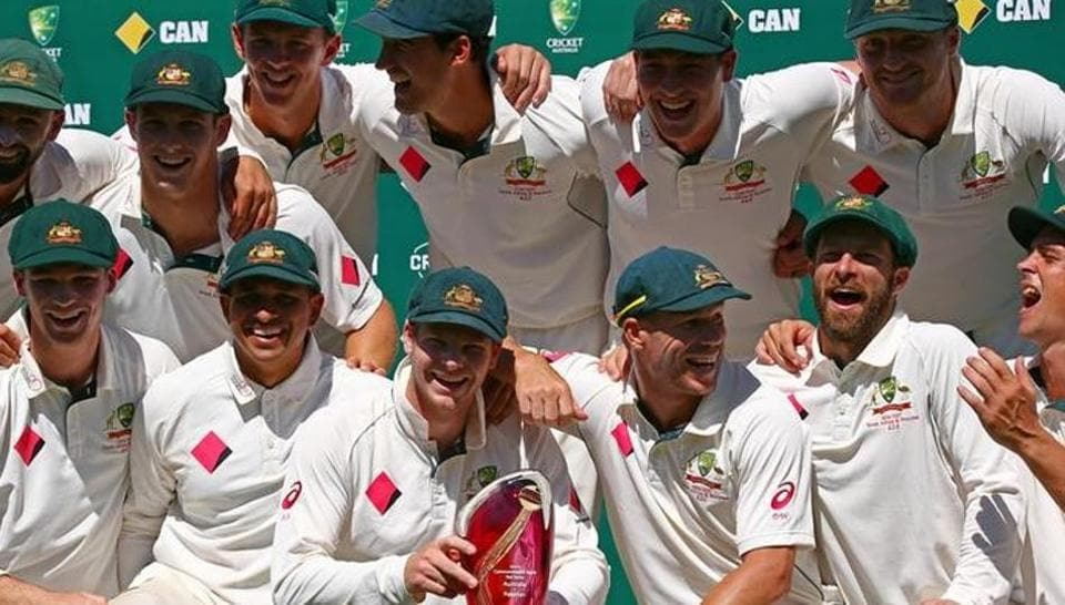 Australia's captain Steve Smith poses with teammates for an official photo after receiving the Australia vs Pakistan Test series trophy at the Sydney Cricket Ground.