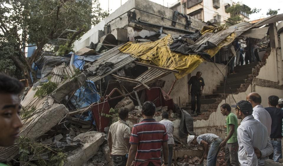 People look at what is left of the restaurant at Turner Road in Bandra on Friday.