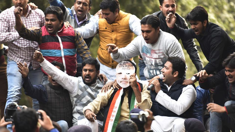 Youth Congress workers hold a protest against the Election Commission and the government over the decision to advance the Union Budget, at new colony in New Delhi.