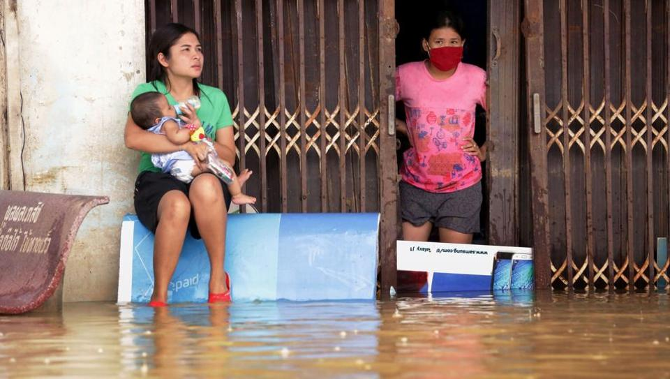 Women look out from a flooded house in the southern Thai village of Chauat on January 7.