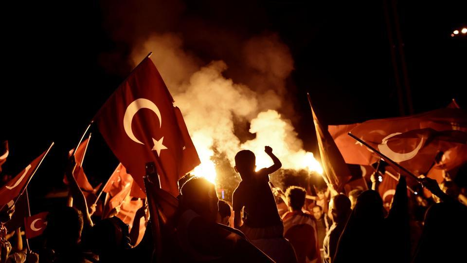 Pro-Erdogan supporters wave Turkish national flags during a rally at Taksim square in Istanbul on July 18, 2016 following the military failed coup attempt of July 15.