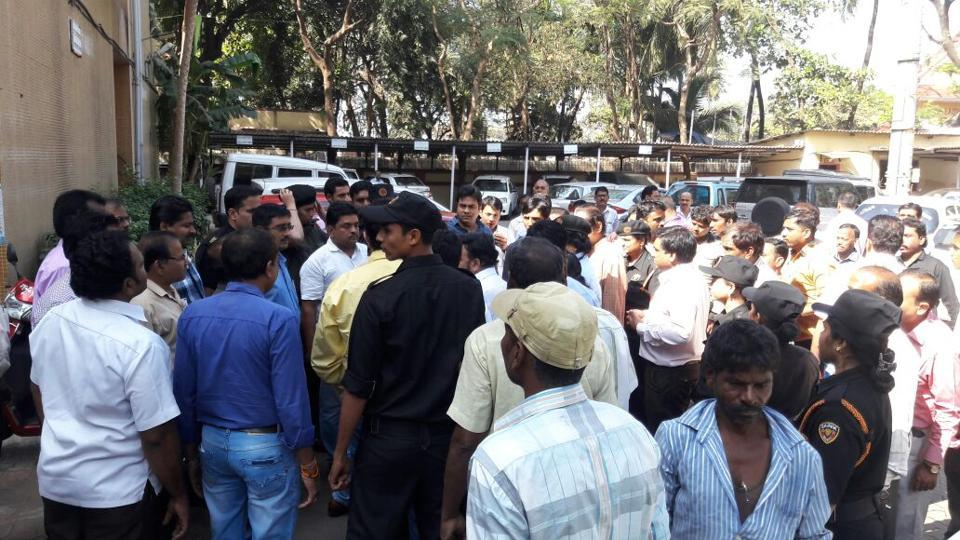 Police keep a watch over the crowd outside the the Mira-Bhayander Municipal Corporation on Friday.