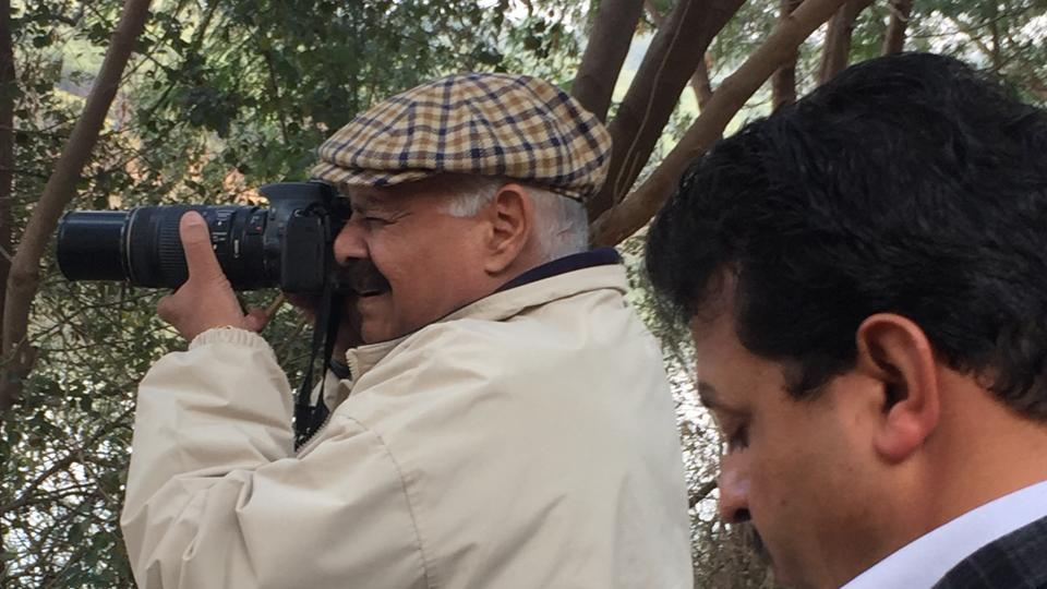 UT Administrator VP Singh Badnore photographs Red-crested pochards at Sukhna lake's rowing canal.
