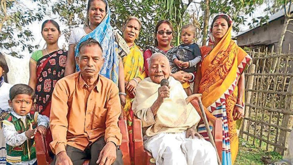 Phulti Barman (seated, in white), well over 100 years old, regales the audience with her tribal songs.