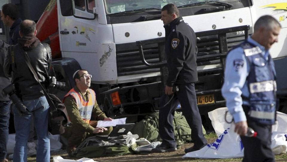 Israeli police investigates the scene of an attack in Jerusalem. A Palestinian rammed his truck into a group of Israeli soldiers in Jerusalem, killing four people and wounding 15 others.
