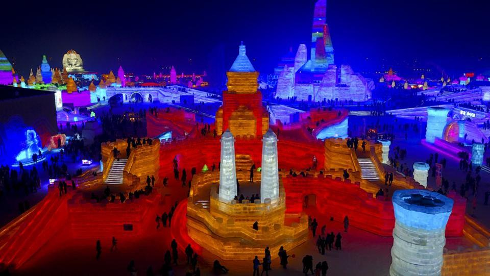 In this December 31 photo, visitors take a tour of a castle-like structure made from blocks of ice at the Harbin International Ice and Snow festival held in Harbin in northeastern's China's Heilongjiang province. The city of Harbin in China's frigid northeast is in its final stages of preparation for one of the world's largest ice and snow festivals, an annual event that last year drew more than a million visitors. (AP)