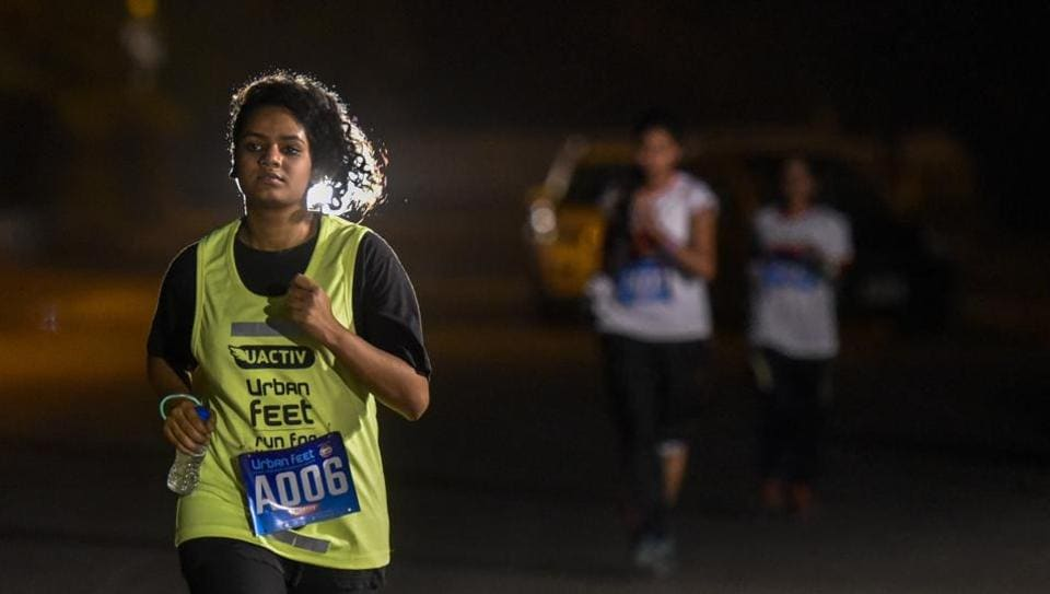 A participant during a 7km night run to spread awareness on women's safety in Mumbai on Saturday. (Kunal Patil / HT Photo)