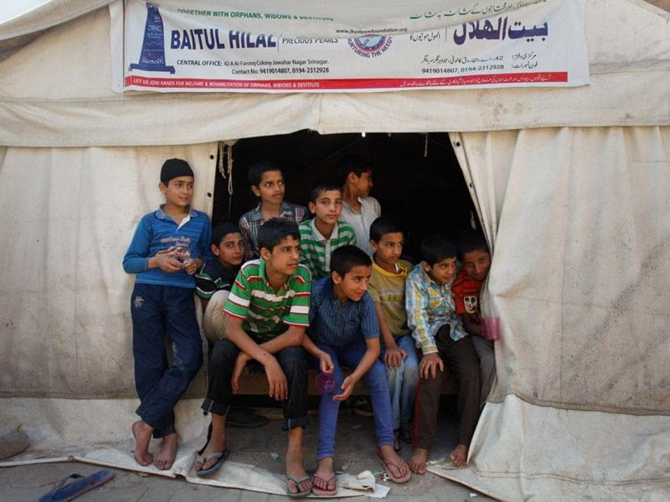 Boys at a temporary orphanage in Srinagar after the 2014 floods. The government has expanded its eligibility criteria for adopting a child in the country, now allowing relatives and step parents to do so too.