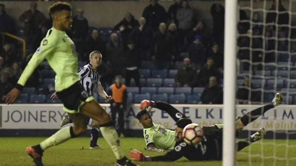Millwall's Shane Ferguson scores their third goal against Bournemouth during their FA Cup third round match at The Den on Saturday.