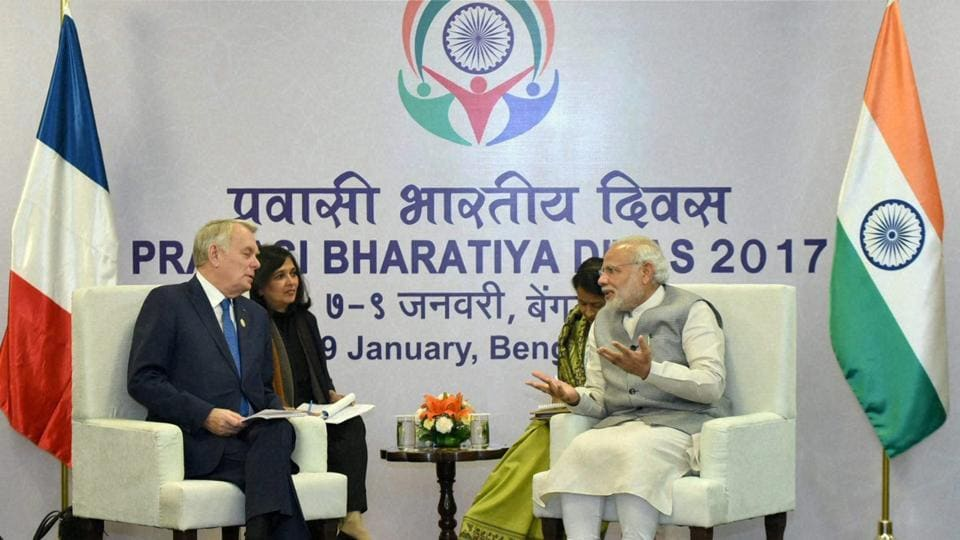 Prime Minister Narendra Modi with Jean-Marc Ayrault, Minister of Foreign Affairs and International Development of France, at the Pravasi Bharatiya Divas celebrations in Bengaluru on Sunday.