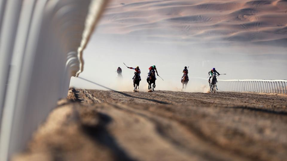 Jockeys compete in a race for purebred Arab horses during the Liwa 2017 Moreeb Dune Festival on January 3 in the Liwa desert, some 250km west of the Gulf emirate of Abu Dhabi. The festival, which attracts participants from around the Gulf region, includes a variety of races (cars, bikes, falcons, camels and horses) or other activities aimed at promoting the country's folklore. (AFP)