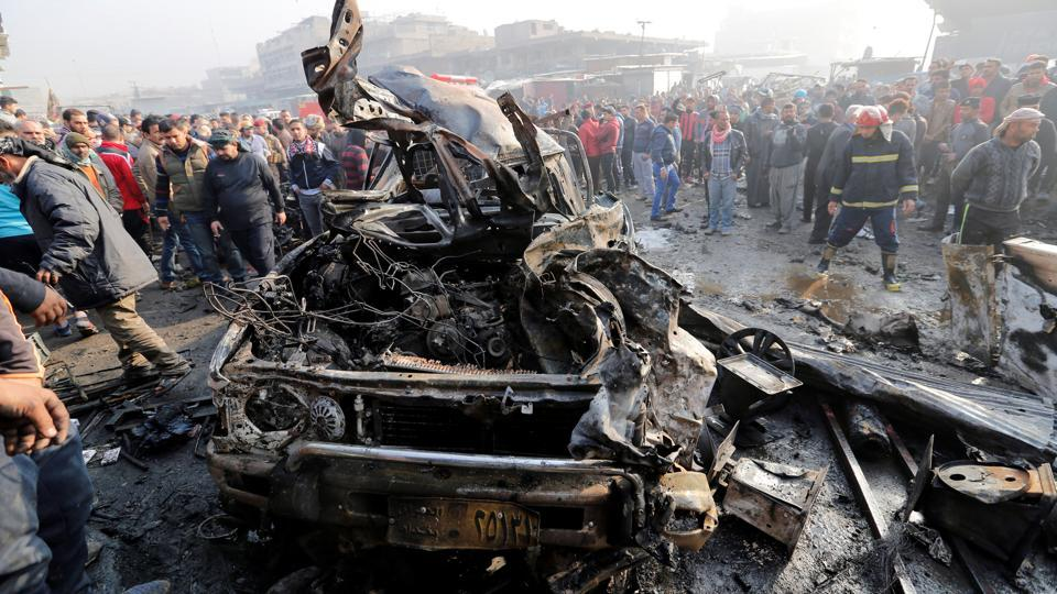 Wreckage at the site of a car bomb attack at a vegetable market in eastern Baghdad, Iraq , on January 8, 2017. The Islamic State claimed the attack.