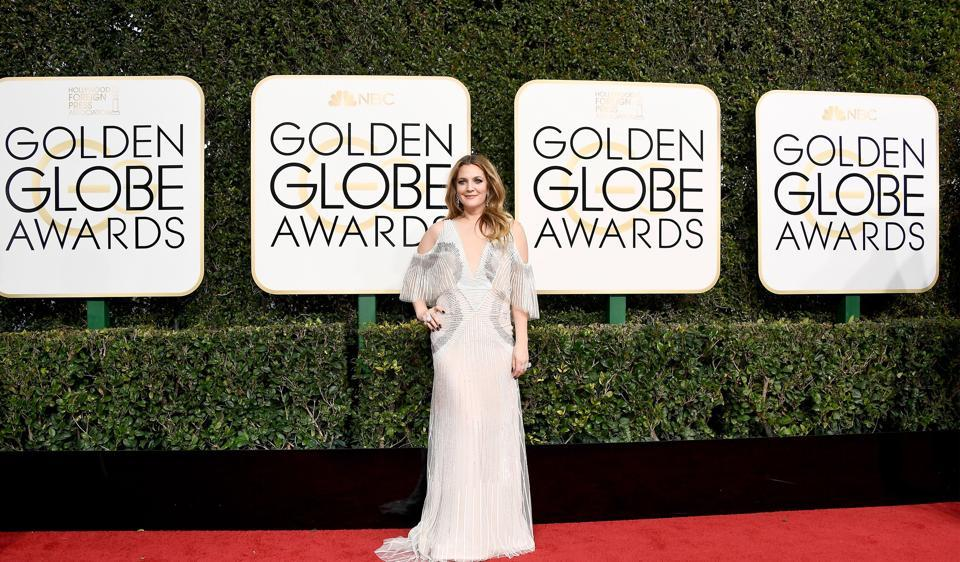 Drew Barrymore in a white cold-shoulder gown.