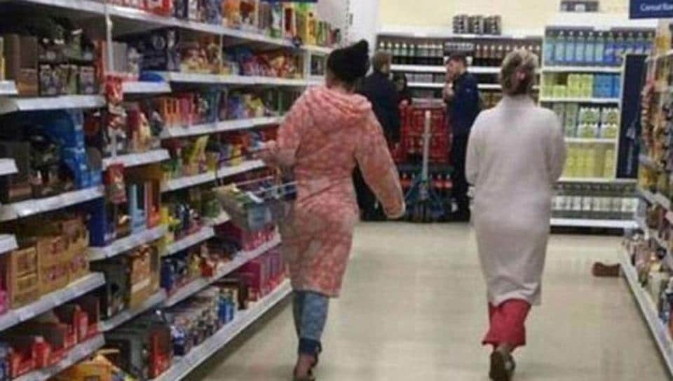 """Two women in the UK who were dressed in pyjamas and dressing gowns at a grocery store said they faced """"racist and sexist"""" taunts online."""