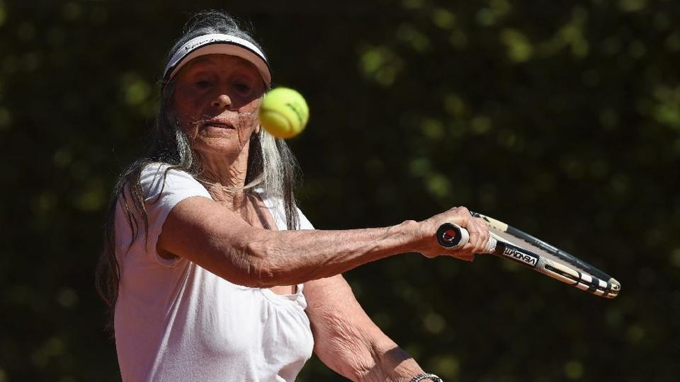 Senior tennis player Ana Obarrio, 83, hits the ball during a tennis match in Hurlingham, Buenos Aires.