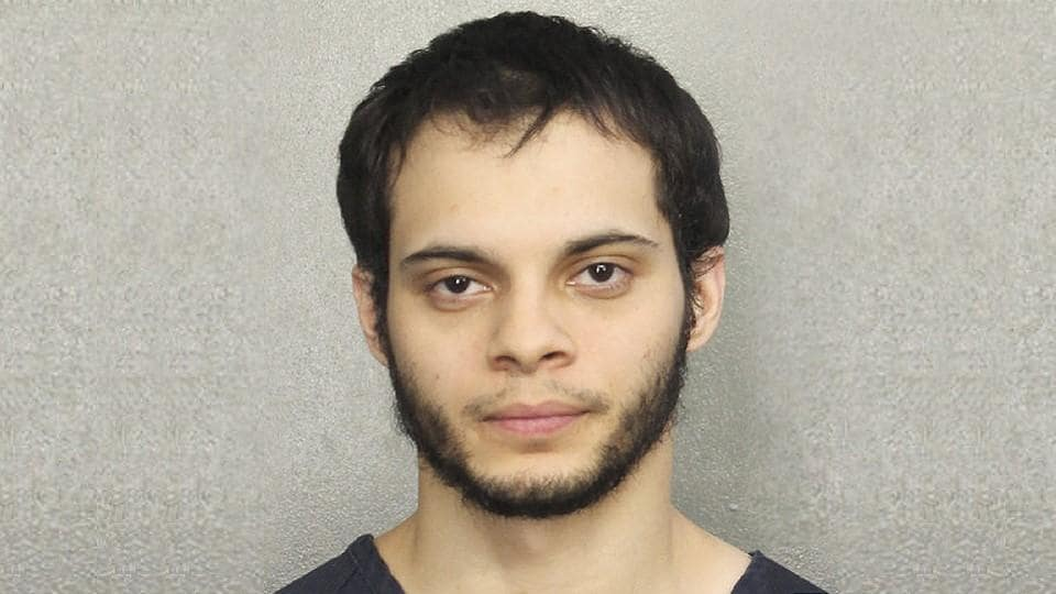 This booking photo provided by the Broward Sheriff's Office shows suspect Esteban Ruiz Santiago, 26, Saturday, Jan. 7, 2017, in Fort Lauderdale, Fla. Relatives of the man who police say opened fire Friday killing several people and wounding others at a Florida airport report.