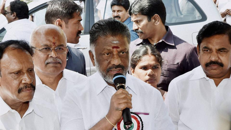 AIADMK treasurer and Tamil Nadu chief minister O Panneerselvam addresses the media outside Poes Garden in Chennai.