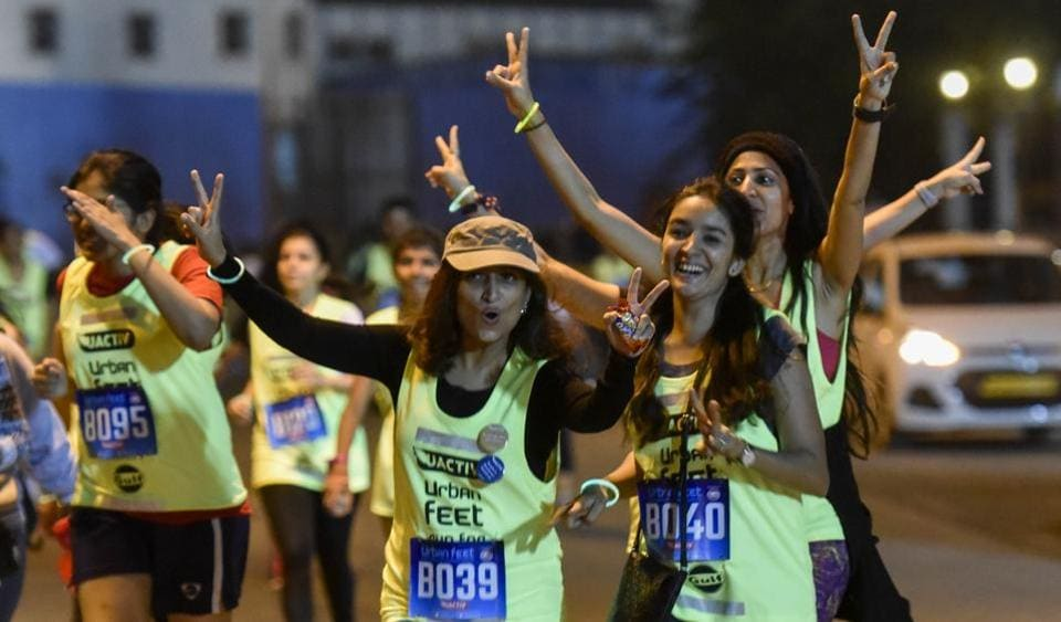Participants at  Urban Feet - Run for Women's Safety event pause to pose for photographs and cheer fellow runners during the midnight run at BKC onSaturday.  (Kunal Patil/HT)