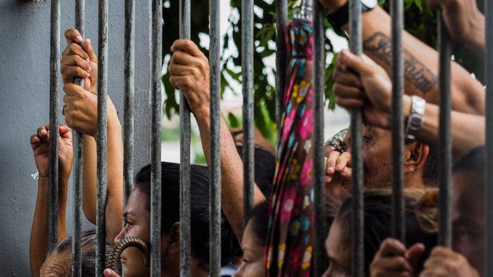 Relatives wait for information following a riot that ended with at least four prisoners killed inside Desembargador Raimundo Vidal Pessoa Public Jail in Manaus, Amazonas, Brazil.