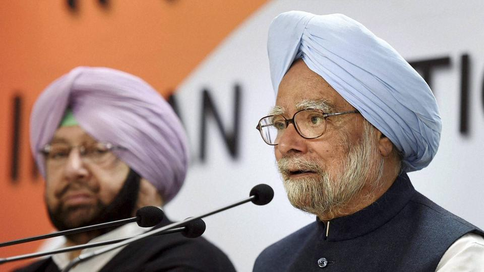 Former Prime Minister Manmohan Singh speaks as Punjab Congress president Capt Amrinder Singh looks on at the release of the party manifesto for the assembly elections in Punjab, at AICC Headquarters in New Delhi on Monday.