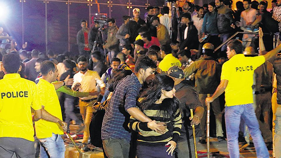 Police personnel manage the crowd during New Year's Eve celebrations in Bengaluru on January 1, 2017.