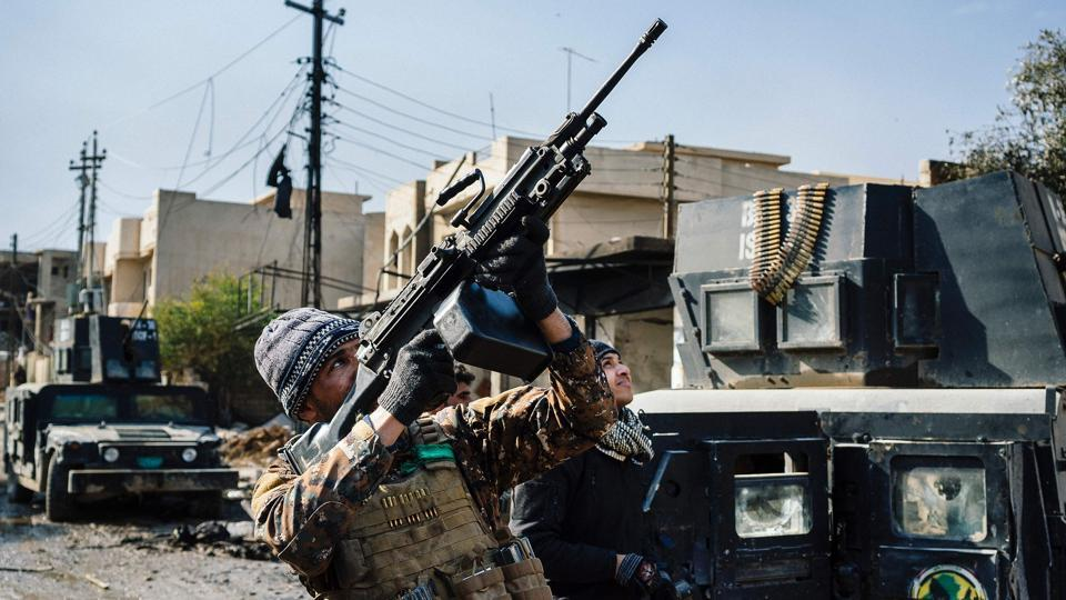 An Iraqi special forces Counter Terrorism Service (CTS) member shoots at a drone flown by Islamic State group jihadists (IS) in Mosul's al-Rifaq neighbourhood on January 8.