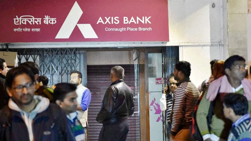 IT officials raid an Axis Bank branch at Connaught Place in New Delhi on  Dec 15.