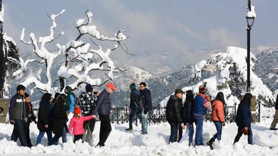Tourists after heavy snowfall at Ridge, Shimla.  (Deepak Sansta / Ht photo)