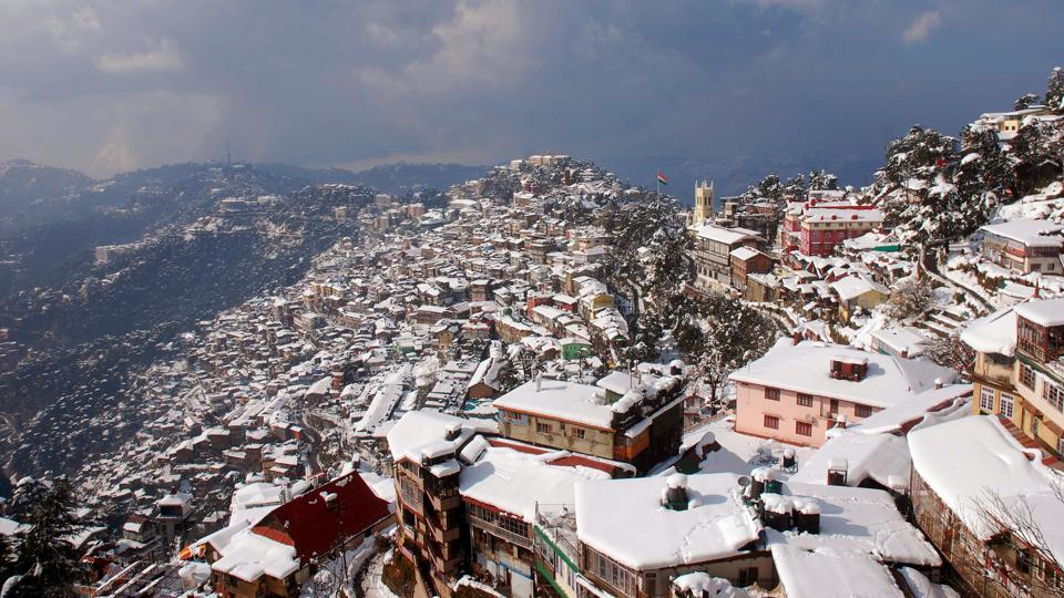 Snow lies on rooftops in Shimla, after heavy winter showers swept across South Asia. (AFP)