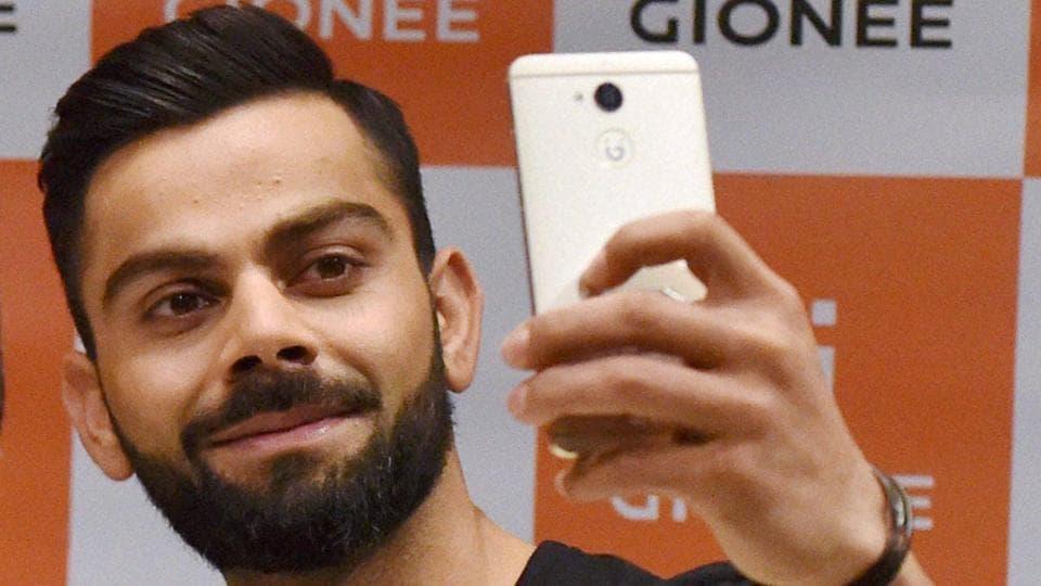 Virat Kohli takes a selfie as a Gionee brand ambassador in Mumbai on Monday.