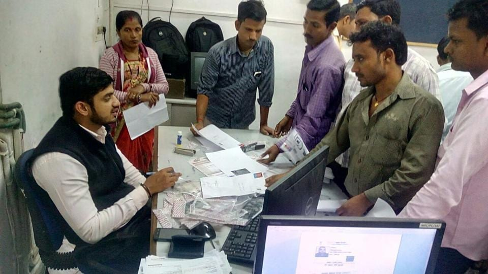 Bank officials collect papers to open accounts for workers at Udyog Vihar on November 29.