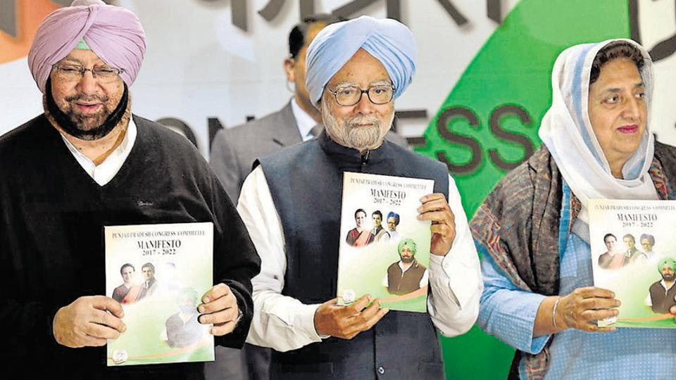 Former PMManmohan Singh along with Punjab Congress chief Captain Amarinder Singh and Rajinder Kaur Bhattal release the Congress manifesto for the February  4 assembly elections in Punjab at AICC HQ, in New Delhi on Monday.